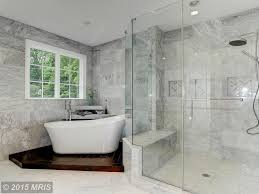 master bathroom with high ceiling u0026 frameless showerdoor in