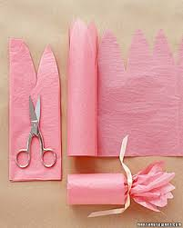 gift wrap with tissue paper fill a toilet paper roll with candy and then wrap pink tissue