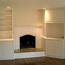 handmade custom built ins on either side of fireplace by best cabinets custommade com