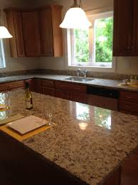 granite countertop kitchen antique white cabinets green