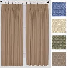 get that exotic look for your living room with pinch pleat drapes