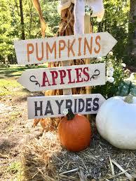 halloween party events fall decor pumpkins apples hayrides arrow direction sign