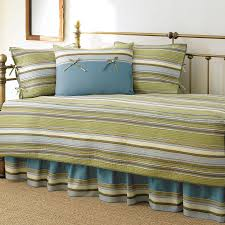 living room vintage style daybed with striped green sheet and