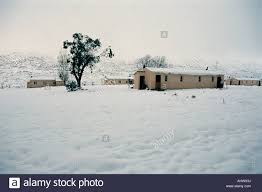 modern low cost houses covered with winter snow in gydo pass