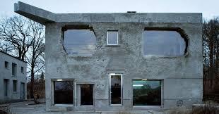 a former german underwear factory now an elegant concrete villa