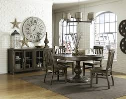 casual dining room sets karlin single pedestal round dining table by magnussen home wolf