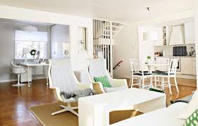 what to do with extra living room space chez larsson after photo of white living room with white coffee