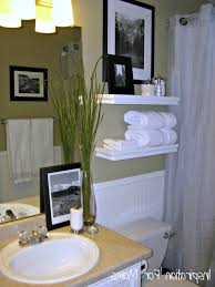 small guest bathroom decorating ideas small and narrow bathroom spaces with floating shelves over toilet