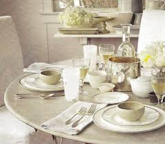 dining room formal dinner table set with white glossy table cloth