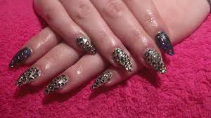 black and gold glitter with leopard print acrylic nails acrylic