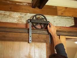 Install Sliding Barn Door by How To Build A Sliding Barn Door Diy Barn Door How Tos Diy
