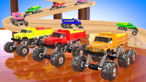 bigfoot presents meteor and the mighty monster trucks dump trucks sliding on a wooden slider teaching colors for