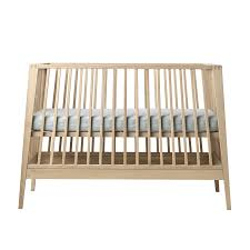 linea by leander baby cot 3 positions and a sofa