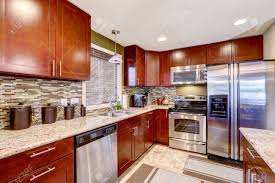 modern kitchen interior with bright wooden cabinets and steel