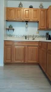 Herringbone Kitchen Backsplash Honey Oak Kitchen Cabinets With Gray Pergo Willow Lake Pine Floors
