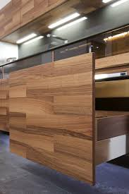 beautiful kitchen design in wood with daring glass additions by