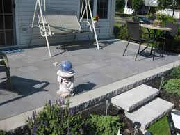 capped backyard cement porch nickett landscaping