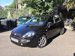 fiat punto evo 1 4 petrol black with red black interior in