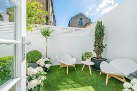 small courtyard designs patio contemporary with swan chairs