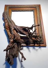 twisted tree branches fused with ornate picture frames by darryl