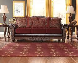 burgundy living room set astound weslynn place benchcraft kitchen