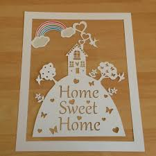 unframed home sweet home paper cut with colourful rainbow