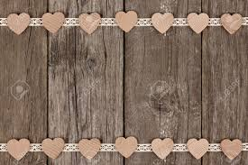 rustic ribbon border of wooden hearts and ribbon lace a rustic