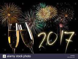 new years chagne flutes chagne flutes and fireworks new year 2017 concept stock photo