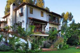 modern spanish style house design cream home with arching doors