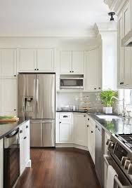 kitchen cabinets with bronze hardware white shaker island cabinets are adorned with rubbed
