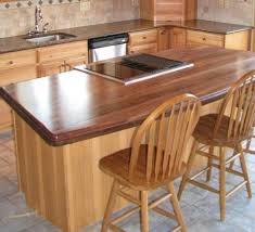 simple kitchen with walnut wood butcher block island countertop