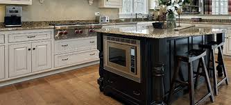 two tone kitchen cabinets with black countertops two tone kitchens combine light and cabinets for a