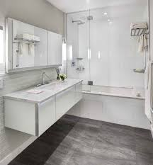 bathroom dark floor contemporary with white countertop modern wall