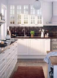 cuisine ikea faktum ikea lidingo with black backsplash my home