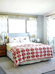 area rugs for bedrooms rug on carpet in bedroom should you put an area rug on carpet