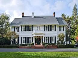 english colonial house style with white wall colors timeless
