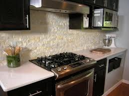 fashionable cobblestone backsplash kitchen with marble countertop