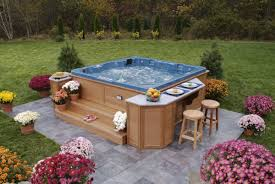 above ground deck tub integrated with stairs and outdoor bar