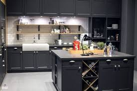 gray cabinets with black countertops gray island with granite countertop exposed white brick floating
