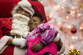 kids receive gifts from santa at the 6th annual clifton johnson