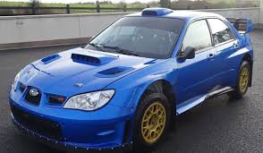 blue subaru gold rims now u0027s your chance to own a wrc spec subaru wrx sti driven by the
