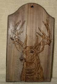 mule deer wild life nature antlers wood burning dark wood