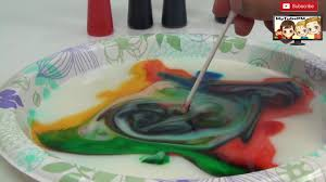 diy rainbow science experiment with milk food coloring and