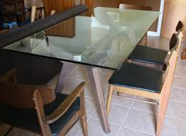 rectangular dining table design with glass top and brown wine rack