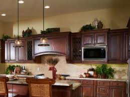 how to decorate space above kitchen cabinets 13 modern ideas for decorating above kitchen cabinets