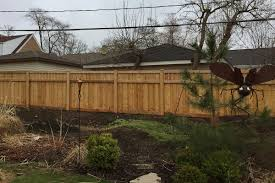 layered traditional wood fence with custom designed topper