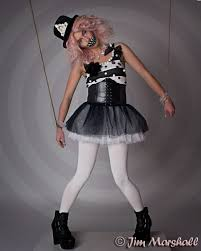 circus puppets like a puppet on a string clown makeup circus themed photoshoot