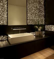 black cabinet and wooden laminate flooring silver wall decoration