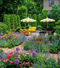 beautiful backyard garden with flowers and privacy trees