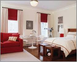 bedrooms bedroom brown accent wall with red comforter for